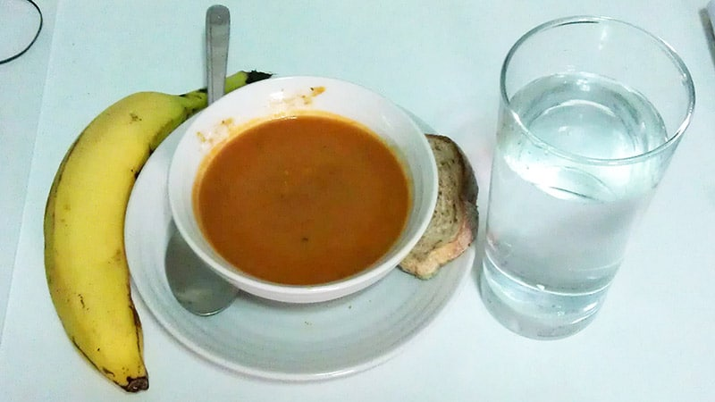 Grilled red pepper and tomato soup, banana, and water