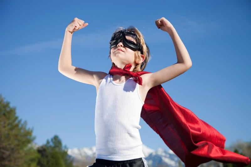 Confident boy with cape