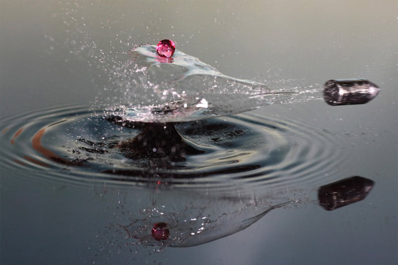 A freeze-frame of a bullet shot through water