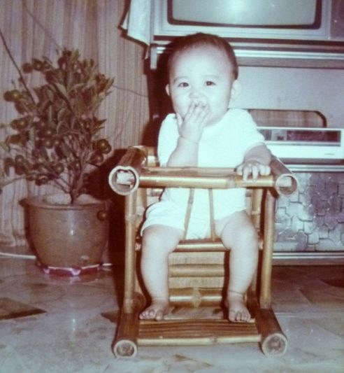 1985: In my wooden baby chair