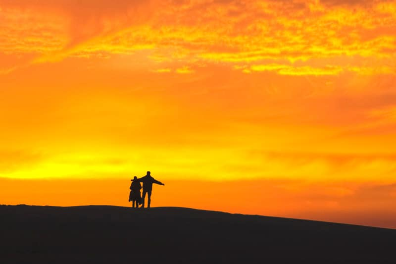 Silhouette of a couple during sunrise