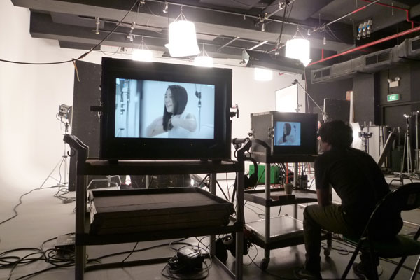Dove Camera Confidence Shoot: Director Julius reviewing the takes