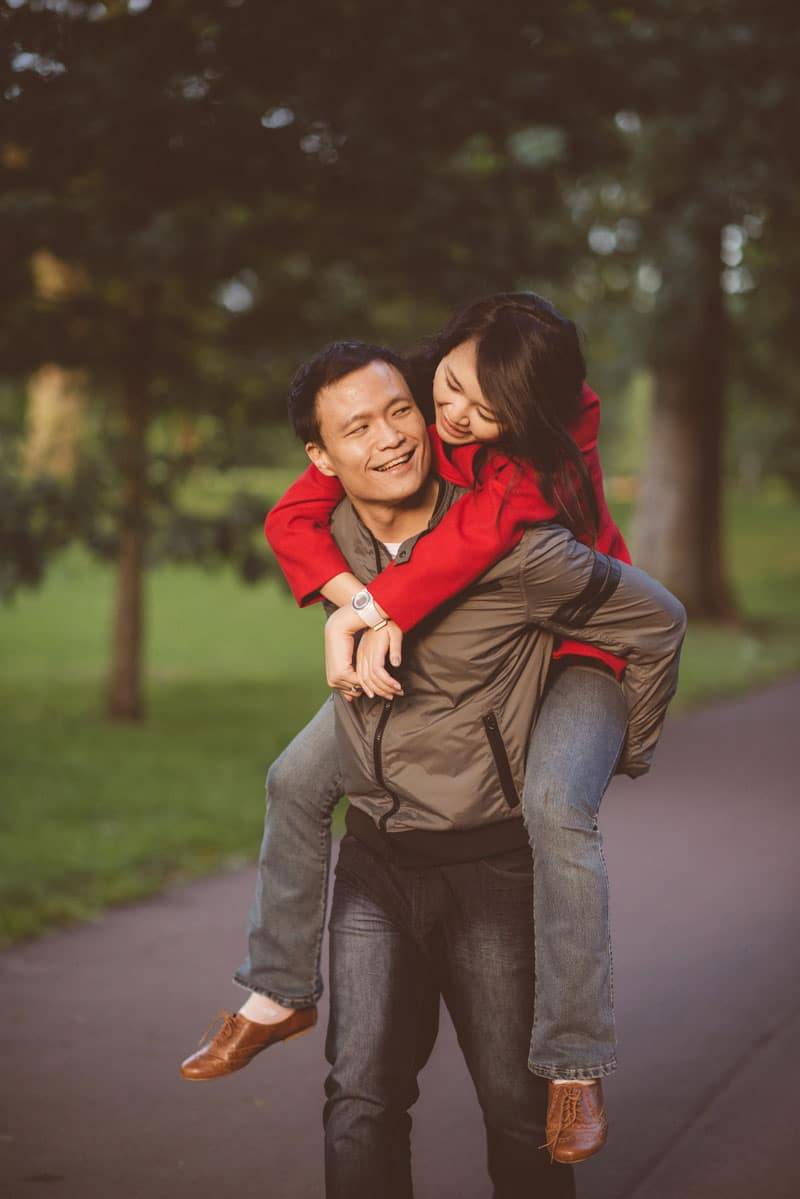 Engagement shoot: Ken giving me a piggyback ride in the forest-park