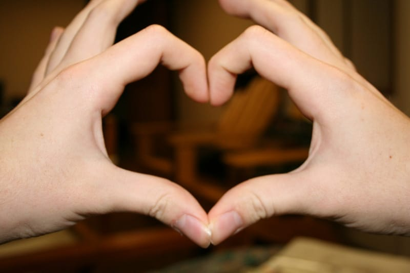 Forming the heart shape with fingers