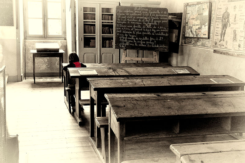 Girl alone in a classroom