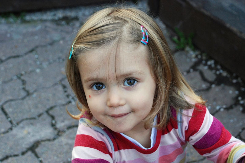 Little girl, hopeful look