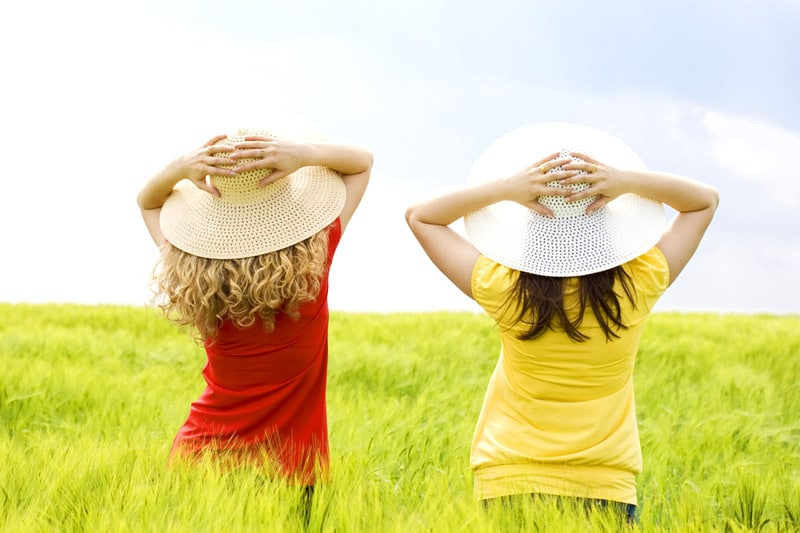Back view of two girls, in the field