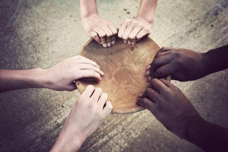 Hands grabbing empty bowl