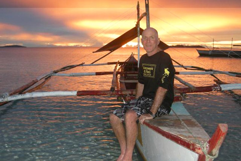 Larry at the sea, during sunset