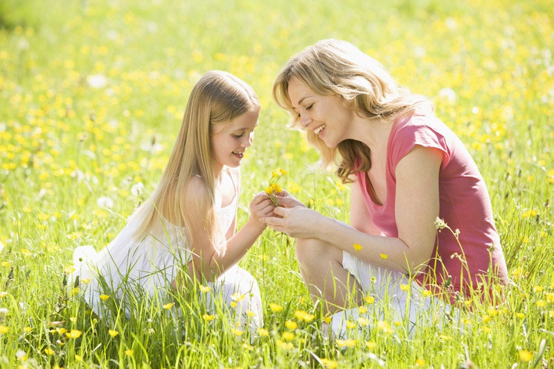 Mother and daughter on the field