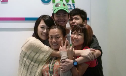 Group hug with morning deejays from UFM 100.3!