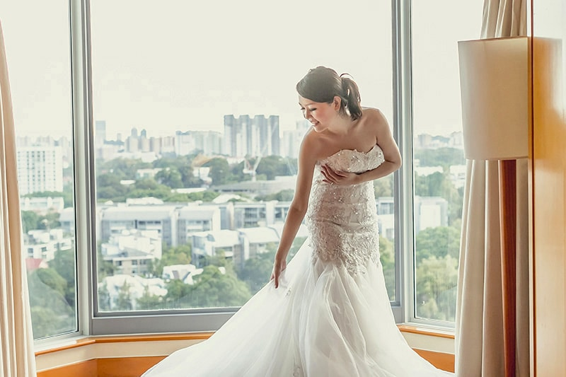 Wearing bridal gown