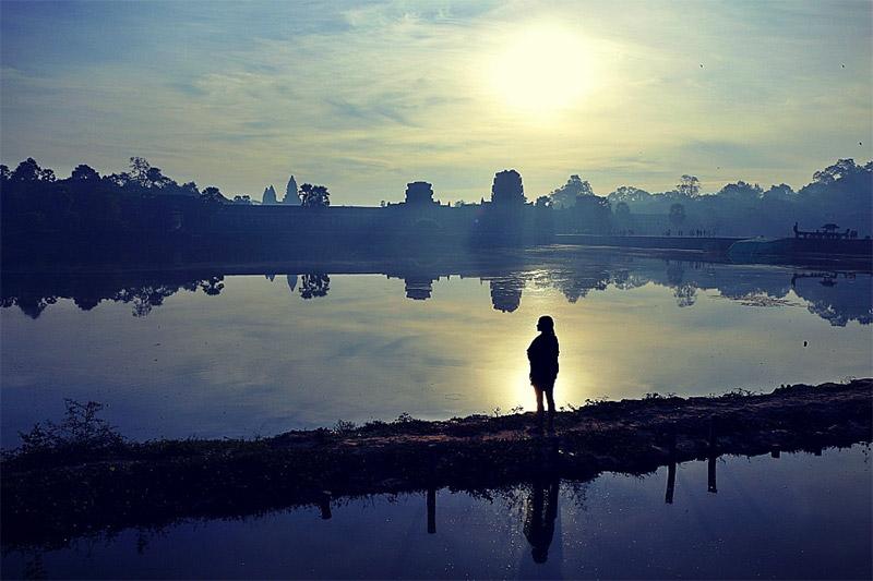 Woman alone by a lake