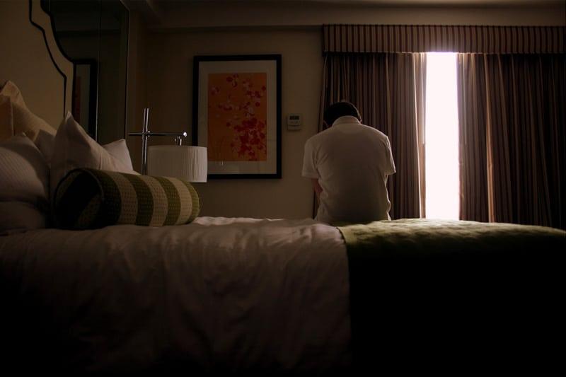 Ashamed man in room
