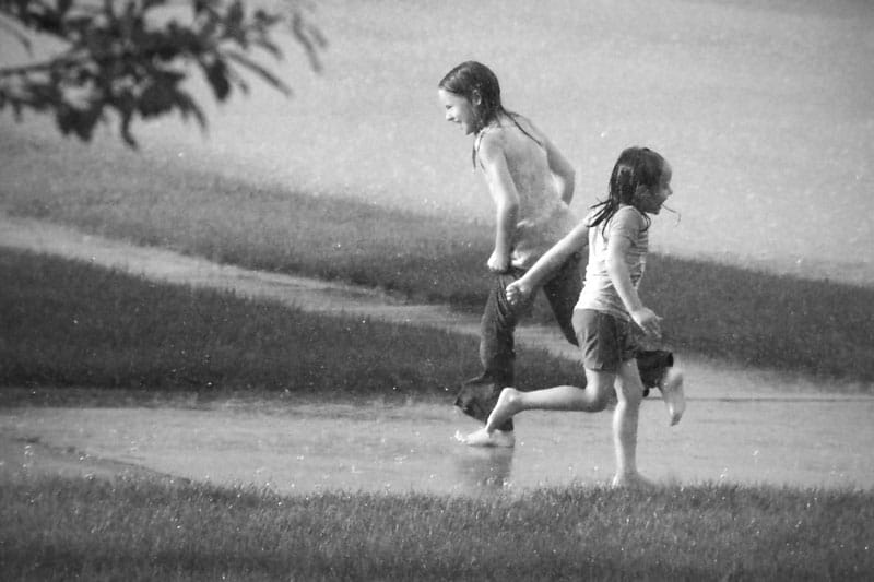 Playing barefoot in the rain