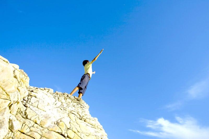 Boy on cliff
