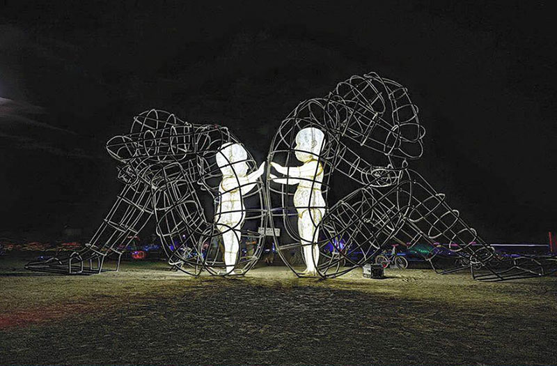 "Burning Man Sculpture ""Love"" - Inner Child Trapped in Us, by Alexandr Milov (Night)"