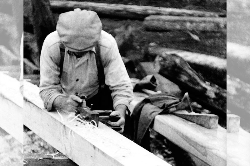 Carpenter woodworking with a plow plane