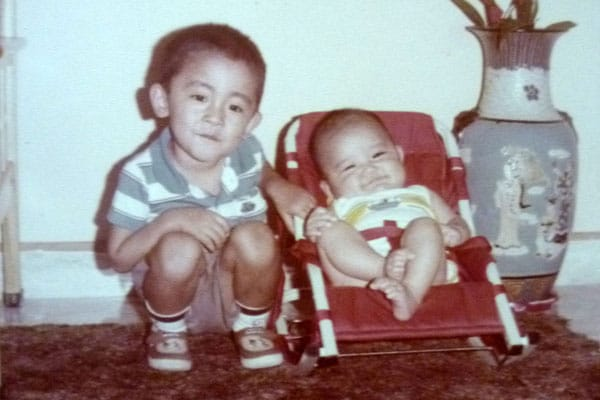 1985: Me in baby cot with my brother