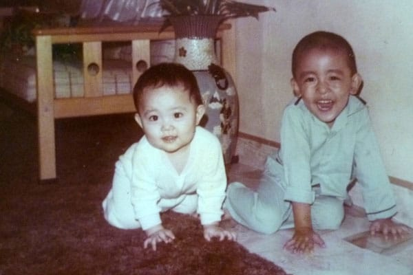 1985: Crawling with my brother beside me :)