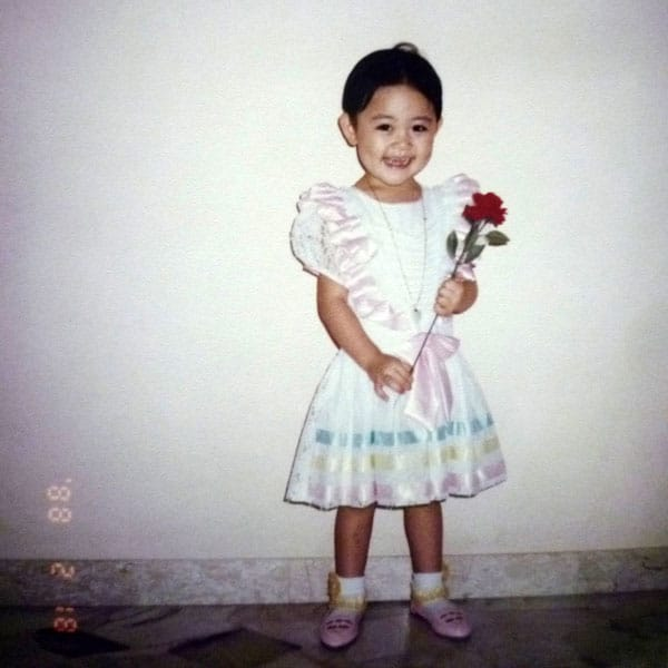 1988: Holding a rose