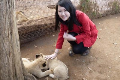 Celes stroking a lion cub in Johannesburg, South Africa