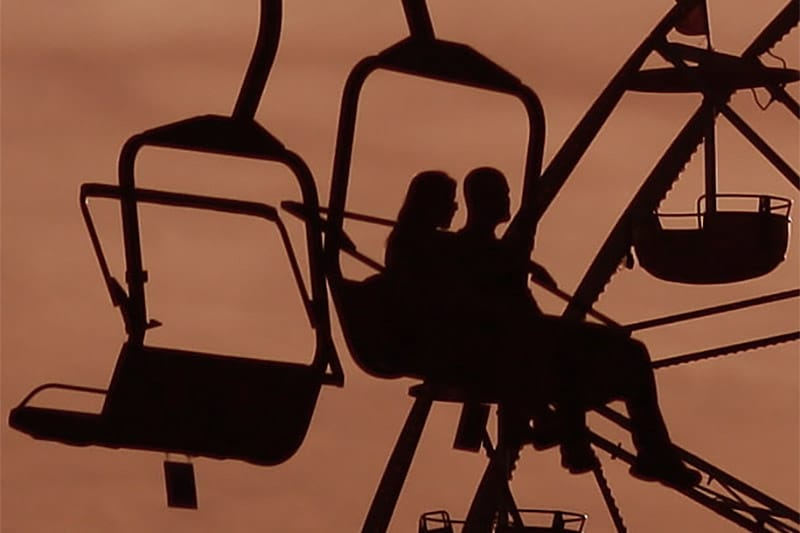 Silhouette of a couple in a cable car