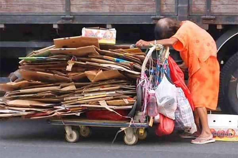An elderly cardboard collector in Singapore