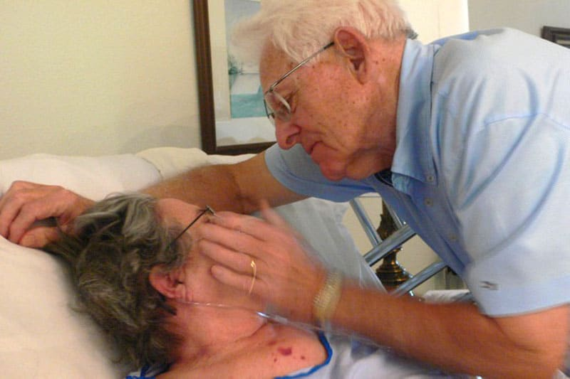 Loving elderly couple at hospice
