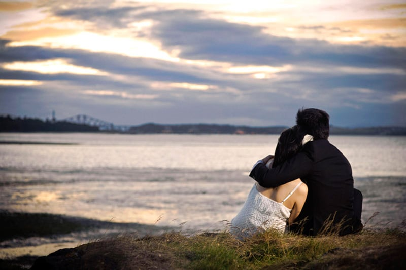 Engagement shoot: Watching the sun set together forever, till the end of time A sweet moment together (Cramond Beach)