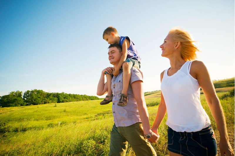 Happy family walking on a field