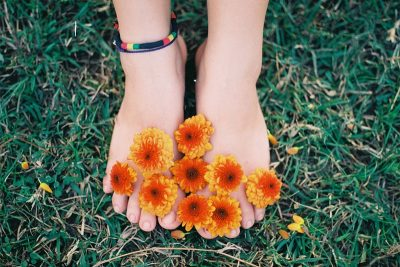 Feet covered with flowers