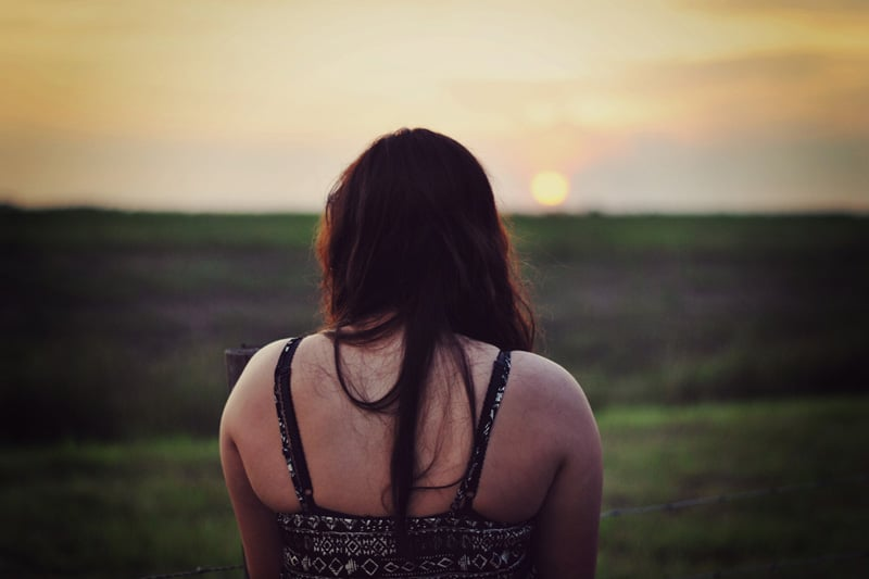 A girl's back view, at the field