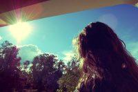 Girl looking at sunlight
