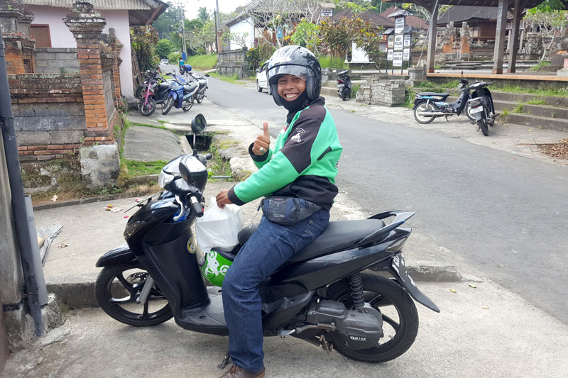 Go-Jek driver delivering GO-FOOD
