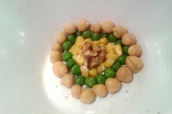 Peas, arranged in a heart shape