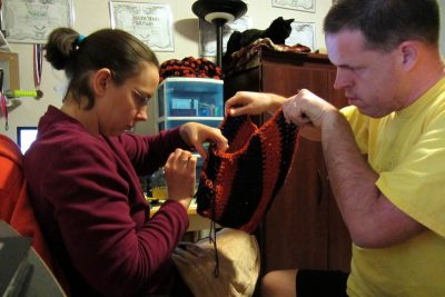 help-mom.jpg Child helping mom to knit