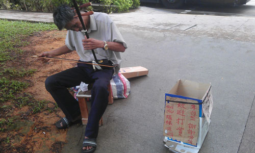 Donating to a Street Performer