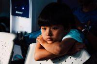 Little kid, alone in a dark room