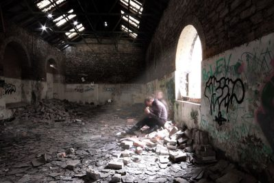 Man alone in a room with debris