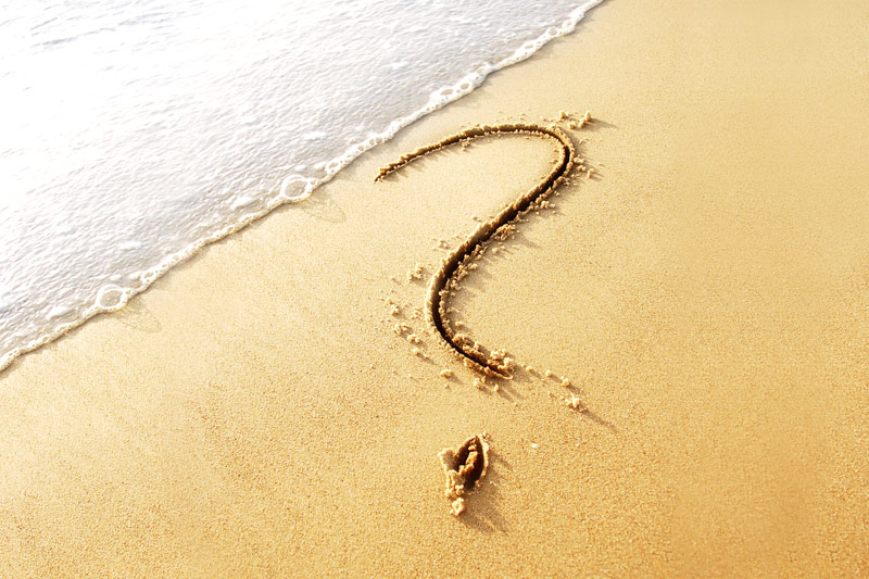 Question mark on sand