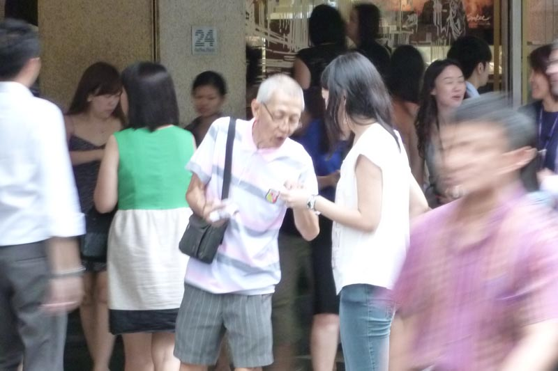 Celes hugging a senior citizen