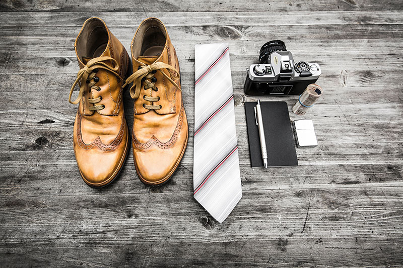Work attire and equipment: Shoes, Tie, Camera, Notebook, Pen, Money