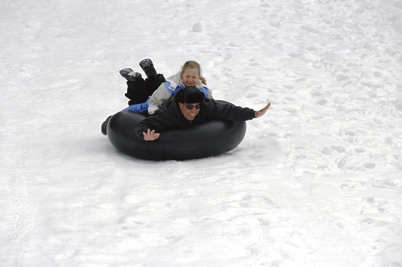 Father and daughter playing on the snow