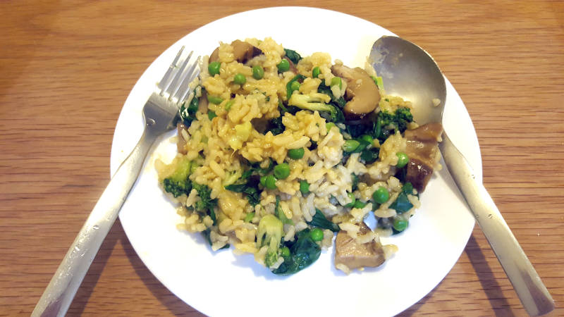 Vegan Meal: Vegan risotto with peas, spinach, broccoli, and mushroom