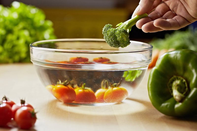 Vegetables and broccoli, put in a bowl