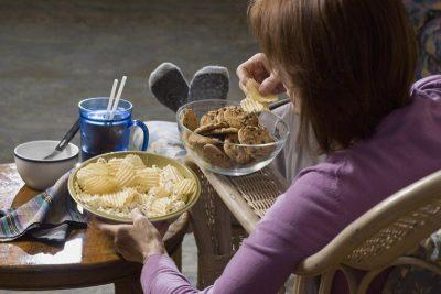 Woman bingeing, eating